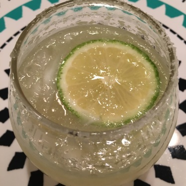 sparkling margarita with floating lime